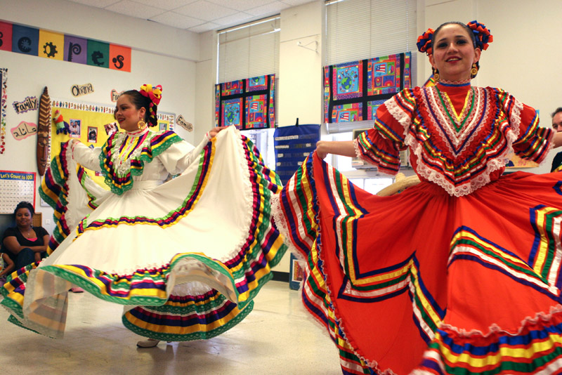 cultural folklore dancing with bright colorful dresses